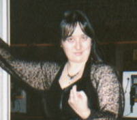 Me in a black lace blouse and skirt