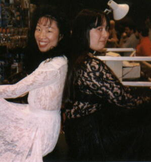 Me in a black dress, with another convention-goer in a white dress